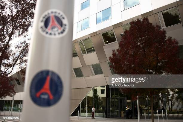 Paris Saint Germain's football club stickers are pictured outside BEIN's Paris offices in BoulogneBillancourt near Paris on October 12 during a raid...