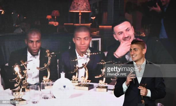 Paris Saint Germain's Italian midfielder Marco Verrati reacts as he receives an award for being selected as a member of the ideal French L1 team...