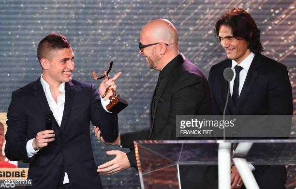 Paris Saint Germain's Italian midfielder Marco Verrati reacts as he receives an award for being selected as a member of the ideal French L1 team next...
