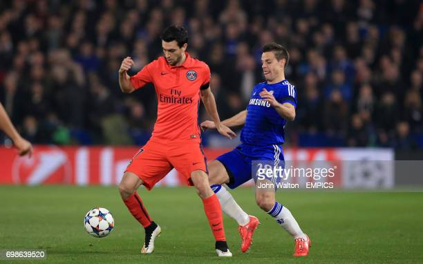 Paris Saint Germain's Javier Pastore and Chelsea's Cesar Azpilicueta battle for the ball