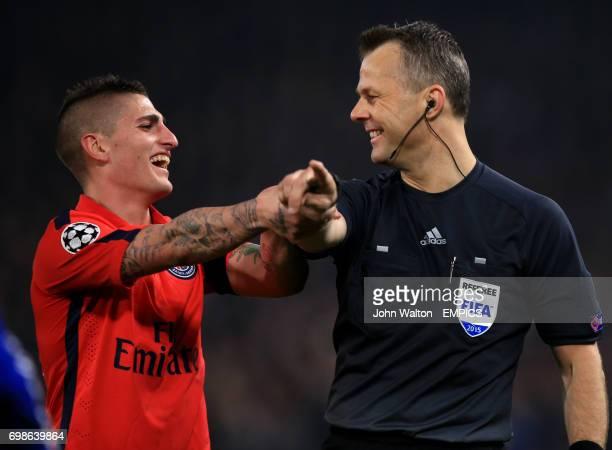 Paris Saint Germain's Marco Verratti shares a joke with referee Bjorn Kuipers