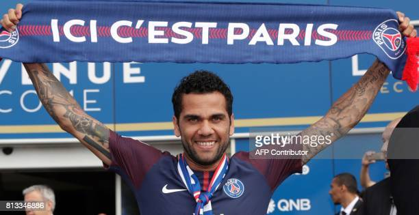 Paris Saint Germain's new Brazilian defender Dani Alves poses with a scarf after a press conference on July 12 in Paris Alves has signed a twoyear...