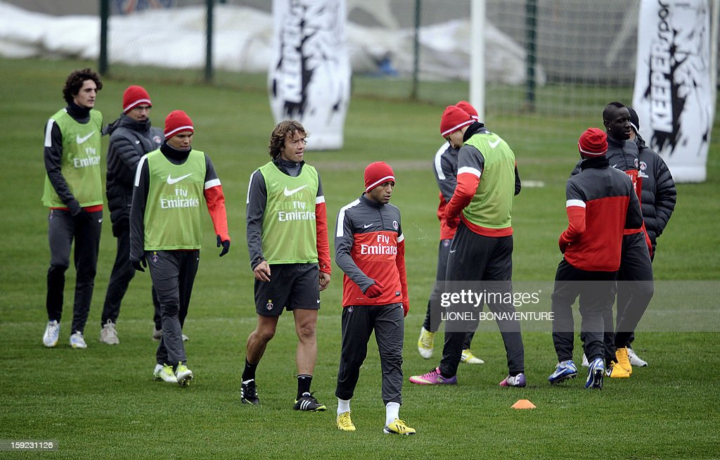 Paris Saint Germain's newly-recruited Brazilian midfielder Lucas Moura (C) takes part in a training session with teammates, on January 10, 2013 at the Camp des Loges, the PSG football club training center in Saint-Germain-en-Laye, west of Paris.