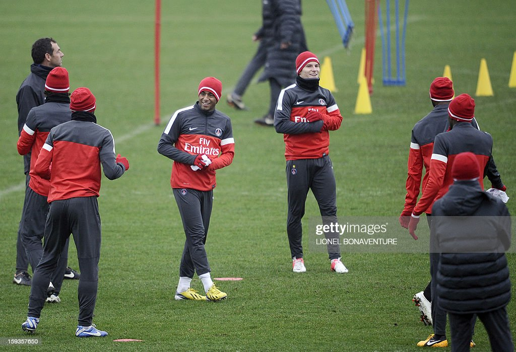 Paris Saint Germain's newly-recruited Brazilian midfielder Lucas Moura (C,L) takes part in a training session beside Paris Saint Germain's French forward Kevin Gameiro (C,R) and other teammates, on January 10, 2013 at the Camp des Loges, the PSG football club training center in Saint-Germain-en-Laye, west of Paris.