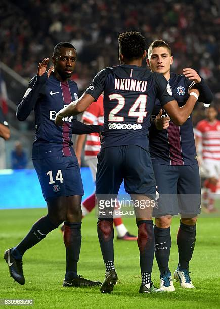 Paris Saint Germain's players congratulate Christopher Nkunku for scoring a goal against Club Africain's team during the friendly football match...