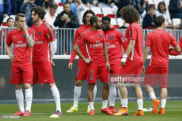 Paris Saint Germain's players warm up prior to the French L1 football match between Nice and Paris Saint Germain on April 18 2015 at the Allianz...