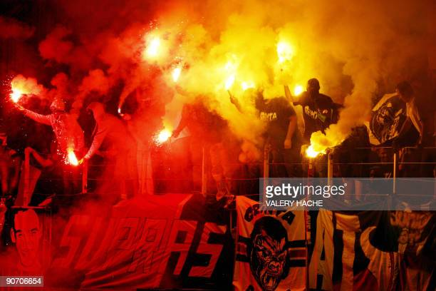 Paris Saint Germain's supporters through smoke bombs during the French L1 football match Monaco vs Paris SaintGermain on September 13 2009 at the...