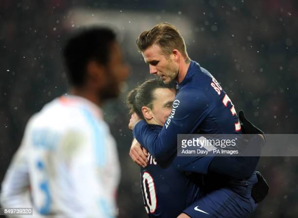 Paris Saint Germain's Zlatan Ibrahimovic elebrates with David Beckham after scoring their second goal during the Ligue One match at Parc des Princes...