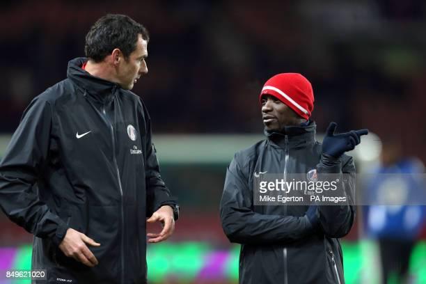 Paris SaintGermain assistant coach Paul Clement speaks with colleague and second assistant coach Claude Makelele