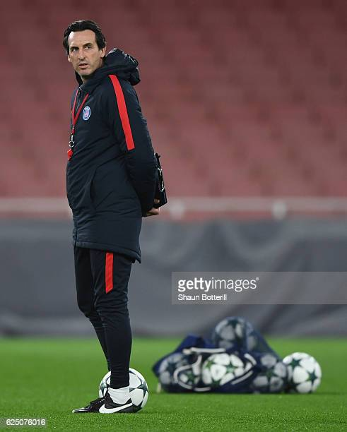 Paris SaintGermain coach Unai Emery looks on during a training session at Emirates Stadium on November 22 2016 in London England