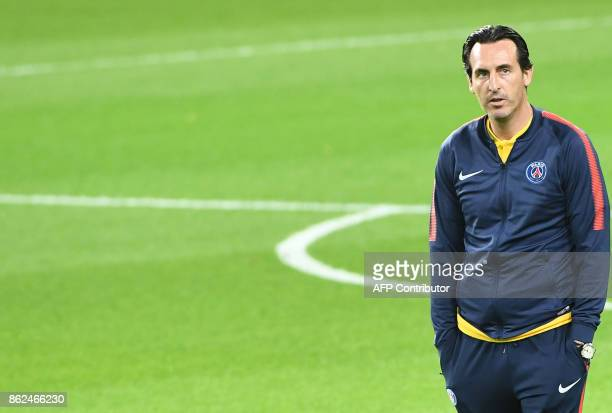 Paris SaintGermain coach Unai Emery stands on the pitch at the Constant Vanden Stock Stadium in Brussels on October 17 2017 during a training...