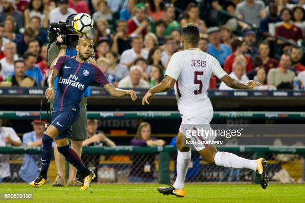 Paris SaintGermain defender Dani Alves try to contain the ball pressured by AS Roma defender Juan Jesus during an International Champions Cup match...