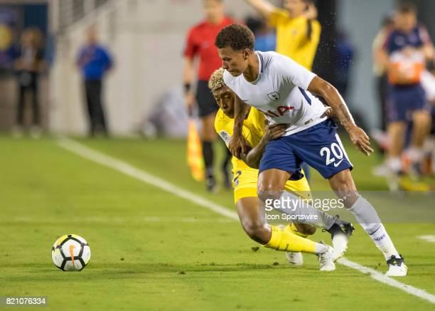 Paris SaintGermain defender Presnel Kimpembe defends Tottenham Hotspur midfielder Dele Alli sideline run during the International Champions Cup match...