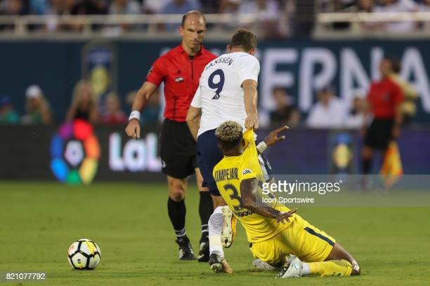 Paris SaintGermain defender Presnel Kimpembe is held while going for the ball by Tottenham Hotspur forward Vincent Janssen during the International...