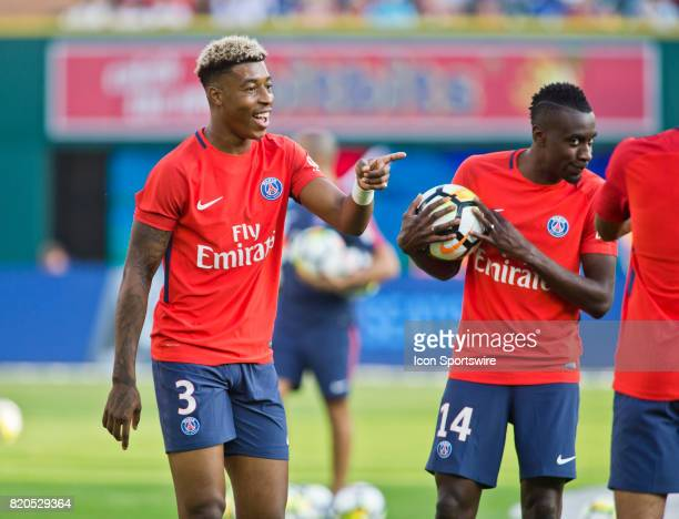 Paris SaintGermain defender Presnel Kimpembe jokes with teammates on the pitch during warmups before an International Champions Cup match between AS...
