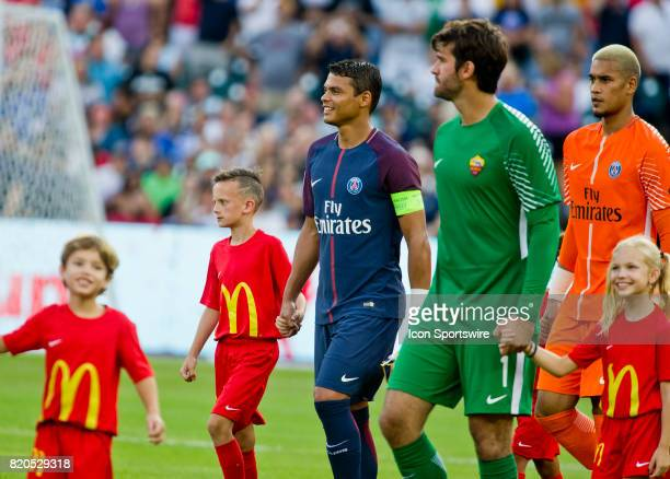 Paris SaintGermain defender Thiago Silva center is lead on to the pitch with teammates by youth escorts before an International Champions Cup match...