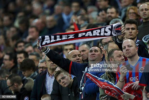 A Paris SaintGermain fan is pictured before the French L1 football match between Caen and Paris SaintGermain on December 19 2015 at the Michel...