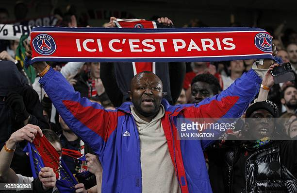 Paris SaintGermain fans celebrate after their team beat Chelsea during the UEFA Champions League round of 16 second leg football match between...