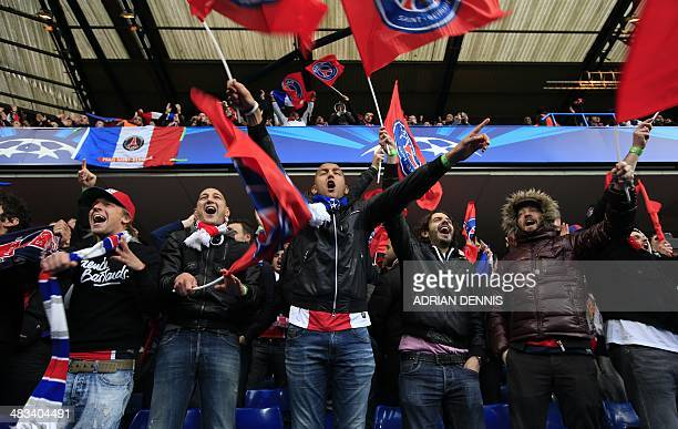 Paris SaintGermain fans cheer in the crowd before the start of the UEFA Champions League quarter final second leg football match between Chelsea and...