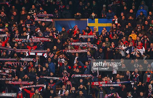 Paris SaintGermain fans show their support during the UEFA Champions League Round of 16 match between Paris SaintGermain and Chelsea at Parc des...