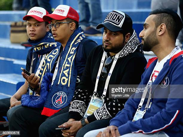 Paris SaintGermain fans watch a practice session ahead of a friendly match against Inter Milan pictured on December 28 2015 at the Aspire Zone in...
