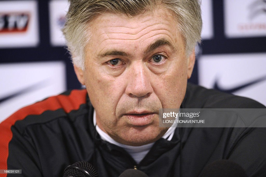 Paris Saint-Germain football club's coach Carlo Ancelotti speaks during a press conference after a training session at the Camp des Loges on January 10, 2013 in Saint-Germain-en-Laye, near Paris. AFP PHOTO / LIONEL BONAVENTURE