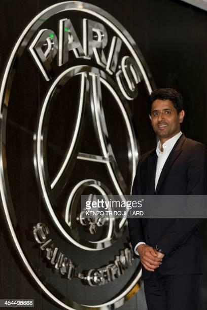 Paris SaintGermain football club's Qatari president Nasser AlKhelaifi poses by the club's logo at the Parc des Princes stadium on September 2 2014 in...