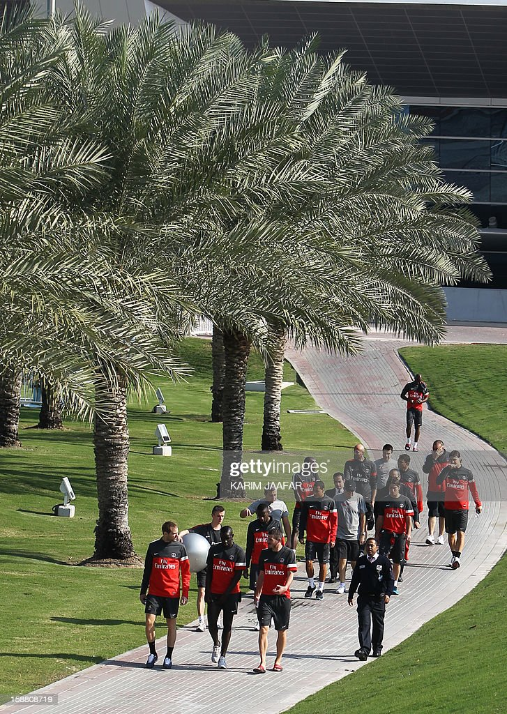 Paris Saint-Germain (PSG) football players and staff arrive for a training session at the Aspire Academy of Sports Excellence in the Qatari capital Doha on December 30, 2012. PSG is in Qatar for a week-long training camp before the resumption of the French Ligue 1 after the winter break. AFP PHOTO / AL-WATAN DOHA / KARIM JAAFAR == QATAR OUT ==
