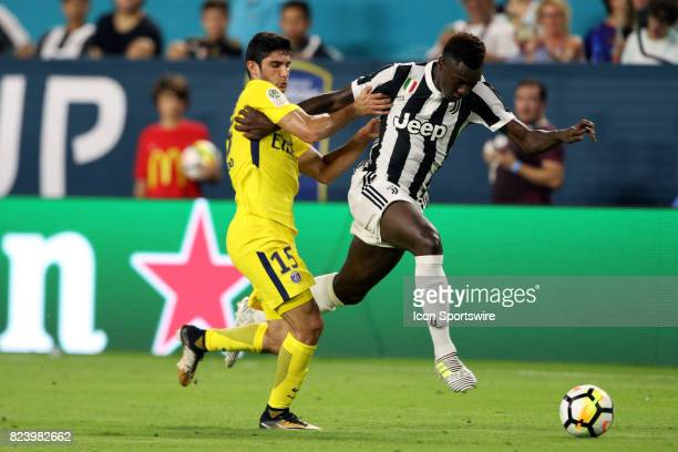 Paris SaintGermain forward Gonçalo Guedes battles Juventus forward Moise Kean during the second half of the International Champions Cup match at Hard...