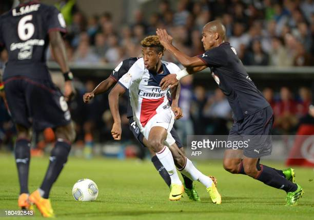 Paris SaintGermain forward Kinsley Coman vies with Bordeaux players during the French L1 football match between FC Girondins de Bordeaux and Paris...