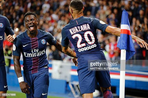 Paris SaintGermain' French defender Layvin Kurzawa celebrates with his teammate Ivorian defender Serge Aurier after scoring during the French Ligue 1...