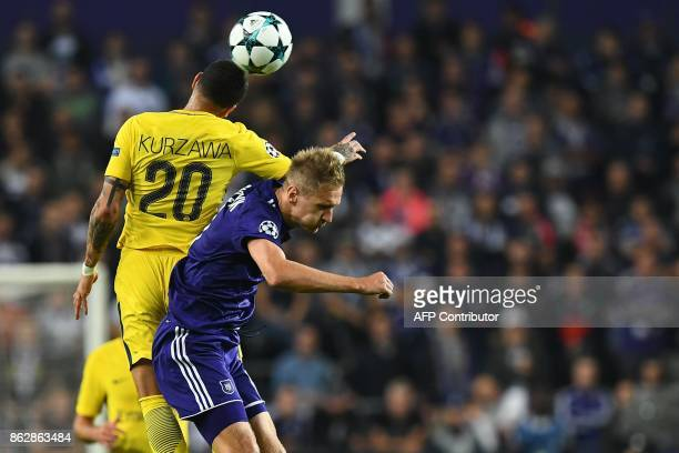 Paris SaintGermain French defender Layvin Kurzawa vies for the ball with Anderlecht's Polish forward Lukasz Teodorczyk during the UEFA Champions...
