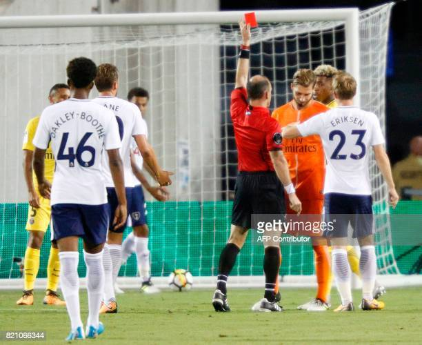 Paris SaintGermain goal keeper Kevin Trapp is sent off by referee Ted Unkel at the start of the second half of their international friendly match...