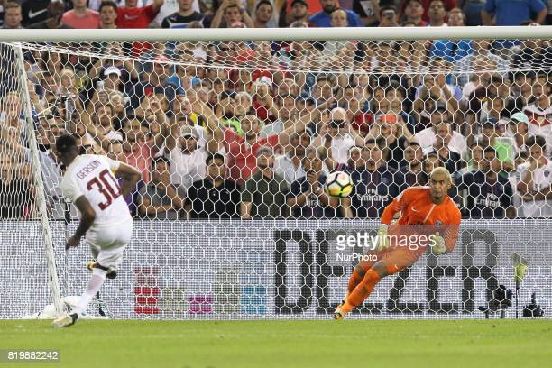Paris SaintGermain goalkeeper Alphonse Areola makes the winning save during penalty kicks to break the tie after the end of regular play during an...