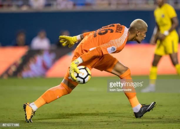 Paris SaintGermain goalkeeper Alphonse Areola passes the ball during the International Champions Cup match between Tottenham Hotspur and Paris St...
