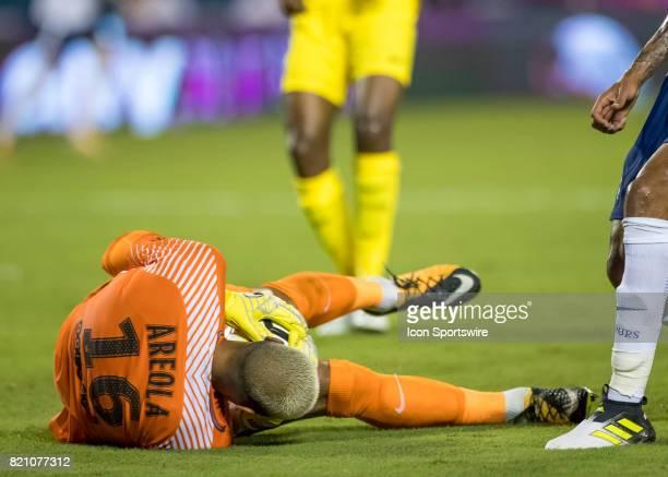 Paris SaintGermain goalkeeper Alphonse Areola saves a goal during the International Champions Cup match between Tottenham Hotspur and Paris St...