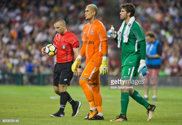 Paris SaintGermain goalkeeper Alphonse Aréola center and AS Roma goalkeeper Alisson are led to a goal for penalty kicks at the end of an...