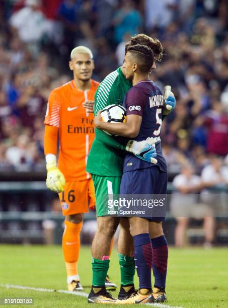 Paris SaintGermain goalkeeper Alphonse Aréola left walks up behind his midfielder Marquinhos consoling AS Roma goalkeeper Alisson after penalty kicks...