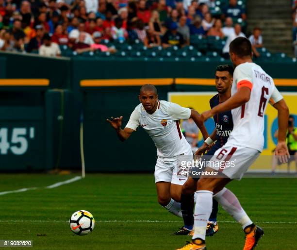 Paris SaintGermain Javier Pastore is defended by AS Roma Bruno Peres and Kevin Strootman in their International Champions Cup match on July 19 2017...