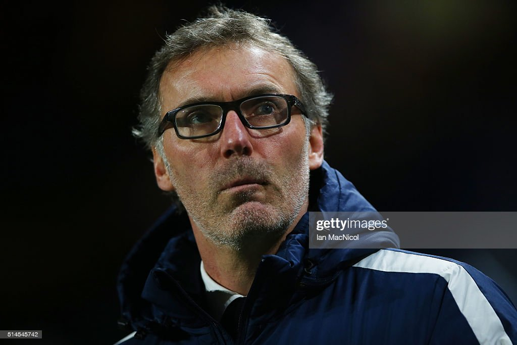 Paris Saint-Germain manager Laurent Blanc looks on during the UEFA Champions League Round of 16 Second Leg match between Chelsea and Paris Saint-Germain at Stamford Bridge on March 09, 2016 in London, England.