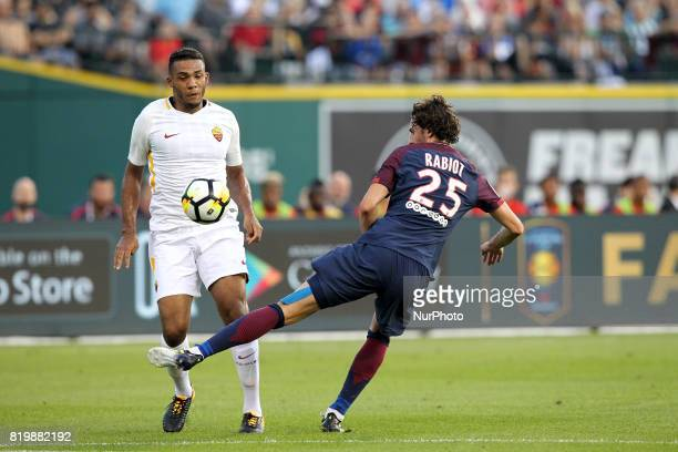 Paris SaintGermain midfielder Adrien Rabiot vies with Roma defender Juan Jesus during an International Champions Cup match at Comerica Park in...