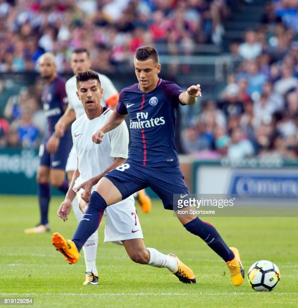 Paris SaintGermain midfielder Giovani Lo Celso steals possession of the ball away from AS Roma defender Luca Pellegrini during an International...