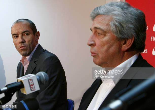 Paris SaintGermain new coach Paul Le Guen former Rangers boss looks at PSG's president Alain Cayzac as they give a press conference 15 January 2007...