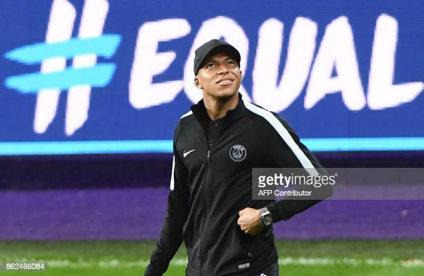 Paris SaintGermain player Kylian Mbappe walks on the pitch at the Constant Vanden Stock Stadium in Brussels on October 17 2017 during a training...
