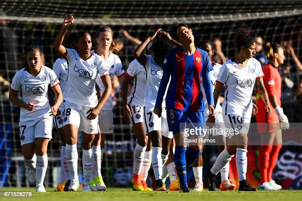 Paris SaintGermain players celebrate after scoring their team's first goal during the UEFA Women's Champions League first leg semifinal match between...