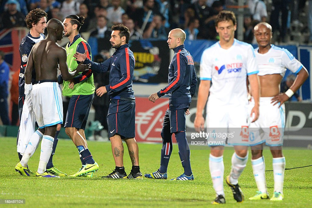Paris Saint-Germain players celebrate at the end of the French L1 football match Olympique de Marseille (OM) vs Paris Saint-Germain (PSG) on October 6, 2013 at the Velodrome stadium in Marseille, southern France.