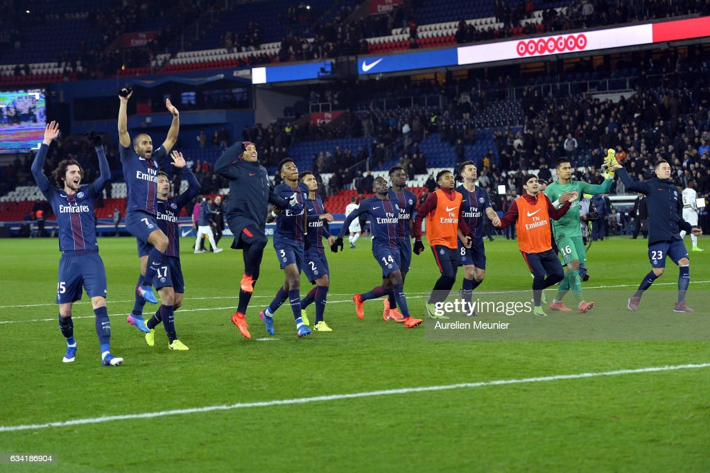 Paris Saint-Germain players cheer with the crowd after winning the Ligue 1 match against Lille OSC at Parc des Princes on February 7, 2017 in Paris, France.