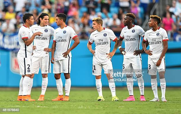 Thiago Silva Edinson Cavani Marquinhos Lucas Digne JeanChristophe Bahebeck and Christopher Nkunku speak during a penalty shootout against Chelsea at...