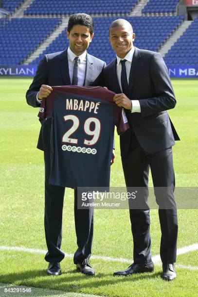 Paris SaintGermain President Nasser Al Khelaifi poses alongside new signing Kylian Mbappe at the Parc des Princes on September 6 2017 in Paris France...