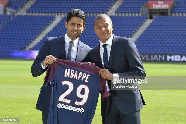 Paris SaintGermain President Nasser Al Khelaifi poses alongside new signing Kylian Mbappe at the Parc des Princes on September 6 2017 in Paris France...